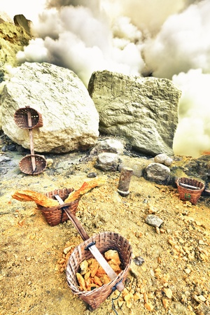 Baskets with sulfur in Ijen crater. Java. Indonesia photo