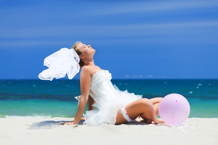 serf: Beautiful young  bride on the tropical beach