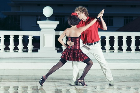 Couple dancing tango at the night time  photo