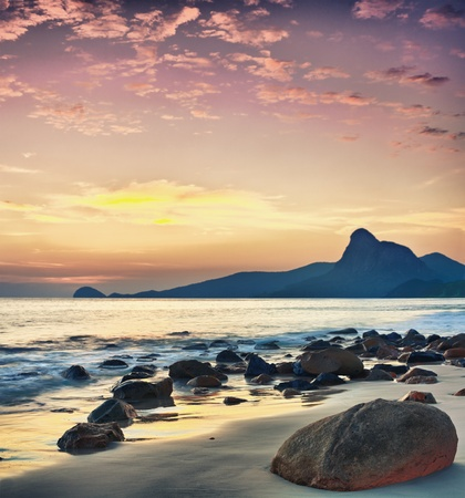 Sunrise over the sea. Stone on the foreground Stock Photo - 9156027