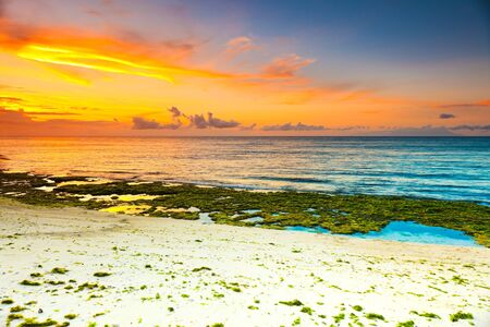 Sunrise over the sea. Stone on the foreground Stock Photo - 9156031