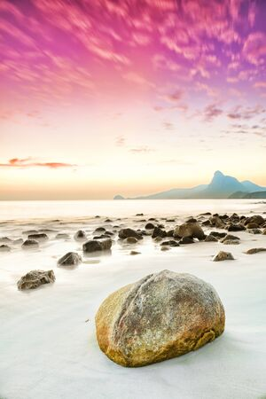 Sunrise over the sea. Stone on the foreground Stock Photo - 9156032