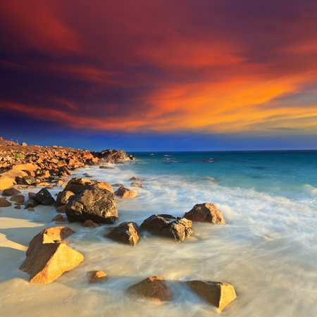 Sunrise over the sea. Stone on the foreground Stock Photo - 9230196