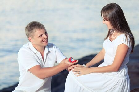 Man proposing to girlfriend and offering engagement ring Stock Photo - 9366030
