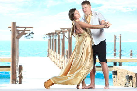 Attractive young couple dancing on the pier Stock Photo - 9366015