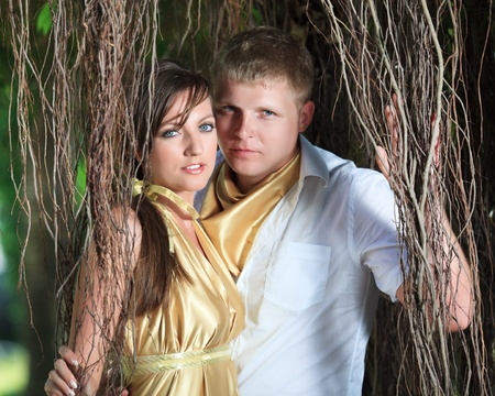 Attractive couple under roots of banyan tree Stock Photo - 9366041