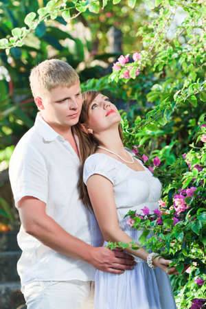 Young attractive couple in the tropical garden Stock Photo - 9414777