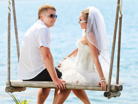 Bride and groom on the tropical beach Stock Photo - 9414743