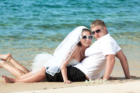 Bride and groom on the tropical beach Stock Photo - 9414771