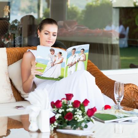 magazines: Beautiful bride sitting and reading magazine about golf