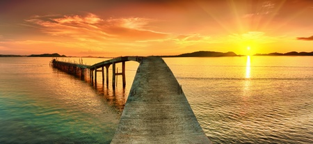 Sunrise over the sea. Pier on the foreground. Panorama
