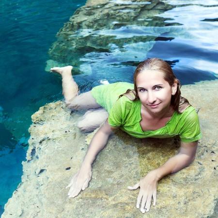 Woman like mermaid in wet dress in lake photo
