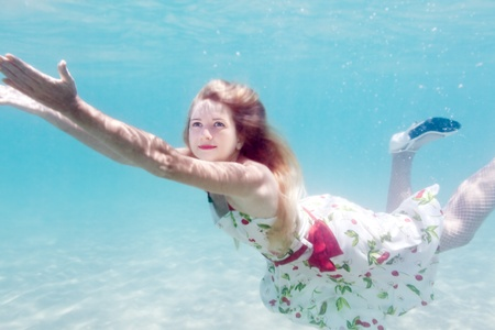 Young beautiful woman in white dress underwater Stock Photo - 9619000