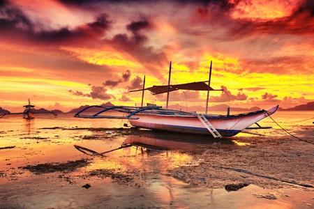 philippine: Traditional philippine boat bangka at sunset time