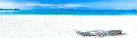 Tropical sandy beach Malcapuya at summer sunny day.Panorama photo