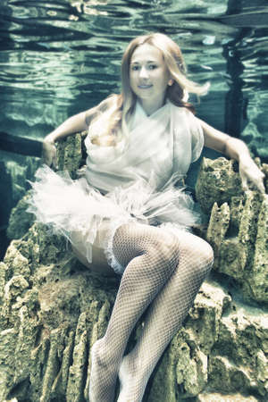 Young beautiful woman in white dress underwater Stock Photo - 9876994
