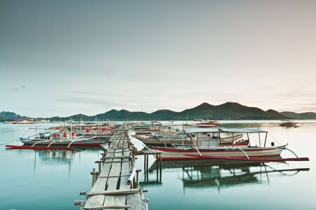 coron: Wooden pier and bahgka boats in Coron