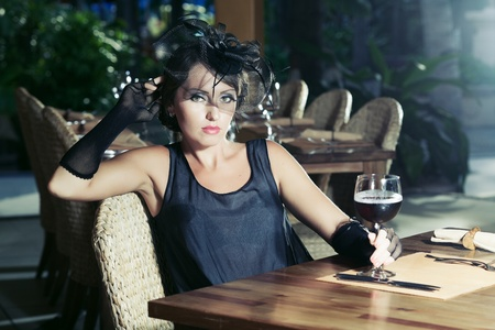 Fashion woman retro portrait in a restaurant Stock Photo - 10098059