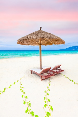 longue: Sandy tropical beach with a deck chairs  Stock Photo