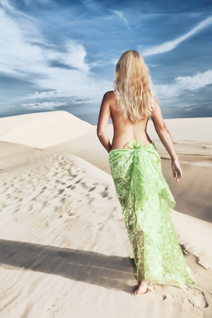 gobi desert: Woman walking among desert dunes at day time Stock Photo
