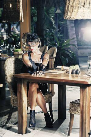 Fashion woman retro portrait in a restaurant photo