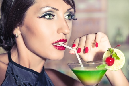 Fashion woman retro portrait with a cocktail