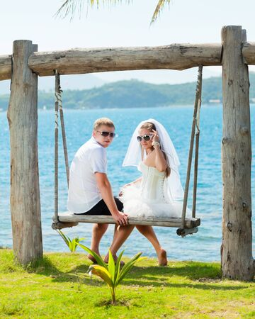 Bride and groom on the tropical beach photo
