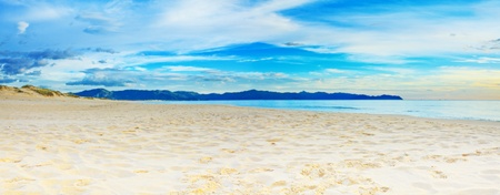 waterscape: Panorama of the tropical sandy beach at sunrise time