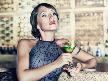 Fashion woman retro portrait with a cocktail Stock Photo - 10452171