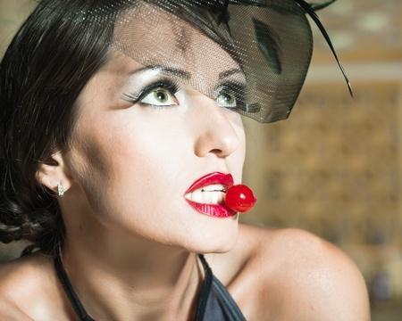 Fashion woman retro portrait with a cherry Stock Photo - 10452204