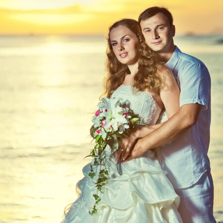 Bride and groom on the beach. Tropical wedding Stock Photo - 10452157