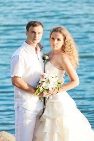 Bride and groom on the beach. Tropical wedding photo