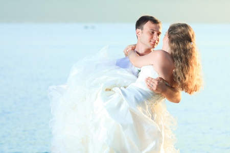 Bride and groom on the beach. Tropical wedding photo