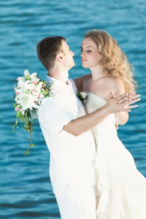 Bride and groom dancing on a rock. Stock Photo - 10587832