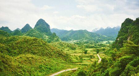 Beautiful mountain valley with road. Panorama. Vietnam 免版税图像