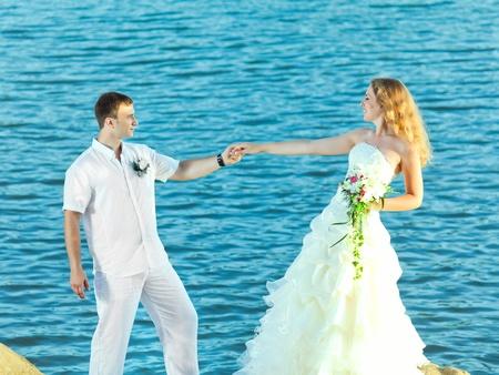 Bride and groom on the beach. Tropical wedding Stock Photo - 10630628