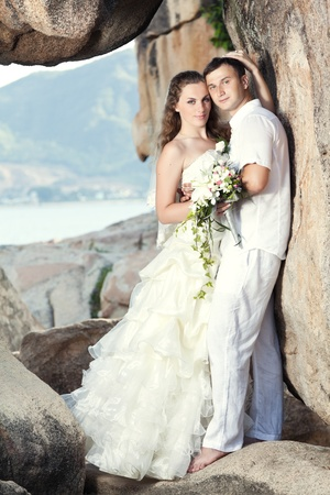 Bride and groom on the beach. Tropical wedding