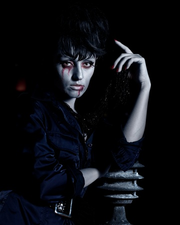 Woman as a vampire. Halloween face art photo