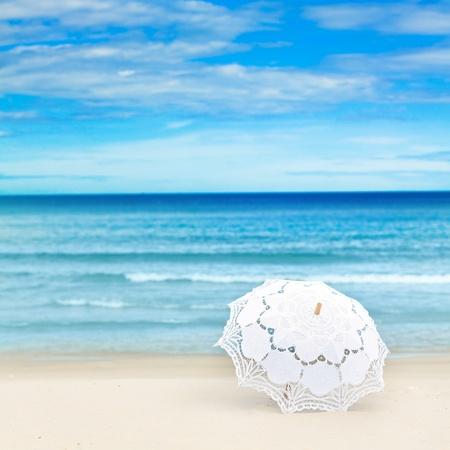 Umbrella on the tropical sandy beach  photo