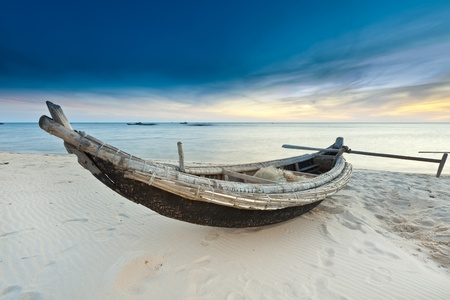 Old fisherman boat at sunrise time. Hue province. Vietnam photo