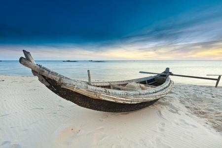 hue: Old fisherman boat at sunrise time. Hue province. Vietnam