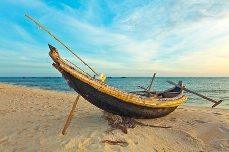 Old fisherman boat at sunrise time. Hue province. Vietnam