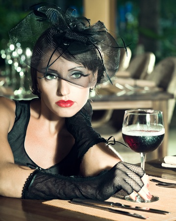Fashion woman retro portrait in a restaurant photo