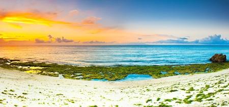 bohol: Sunrise over the sea. Stone on the foreground. Panorama