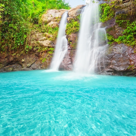 Beautiful waterfall at summer sunny day.