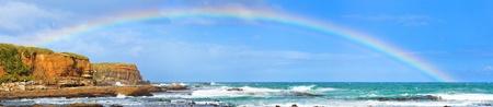 Rainbow over the sea. Panorama Foto de archivo