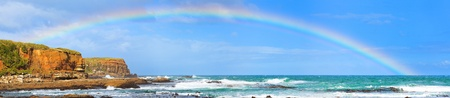 Rainbow over the sea. Panorama photo