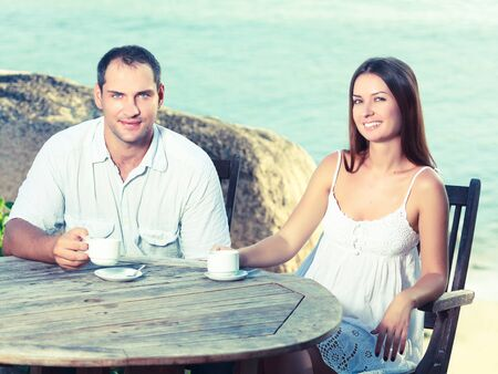 Young couple drinking a morning coffee outdoor Stock Photo - 12960992