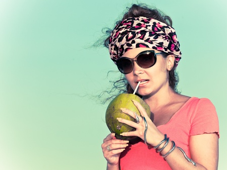Beautiful young woman with coconut photo