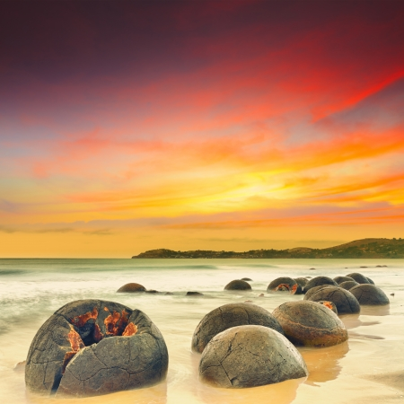 zealand: Moeraki Boulders at sunset  New Zealand Stock Photo